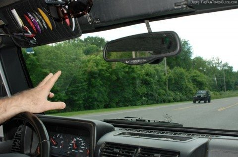 One Jeep owner doing the Jeep Wrangler wave to another Jeep Wrangler driver.
