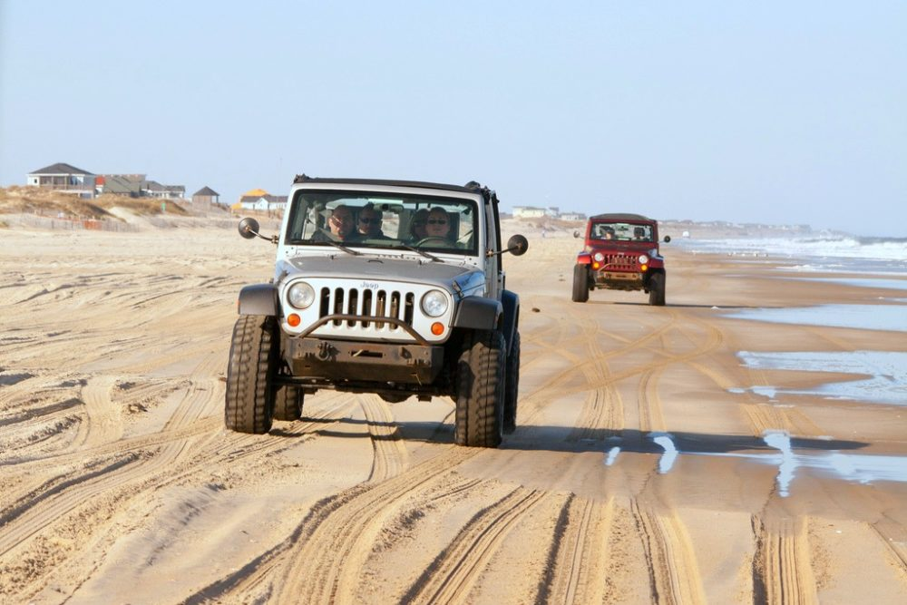Jeeps Driving On The Beach