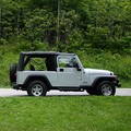 2004 Jeep Wrangler Unlimited parked in the green grass of Gatlinburg, Tennessee.
