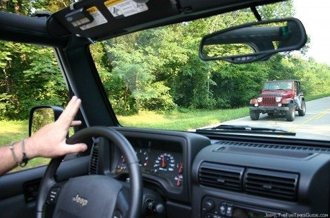jim doing the jeep wave to a fellow jeep wrangler owner