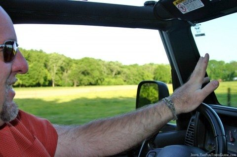 Jim doing the Jeep hand wave to a fellow Jeeper we're passing