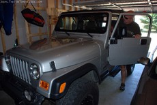 jim-entering-jeep-with-new-lift-kit.jpg