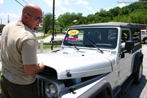 Jim checking out the 2004 Jeep Wrangler Unlimited before we drove it off the lot.