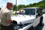 Jim eyeing a 2004 Jeep Wrangler Unlimited with only 2,400 miles on it.
