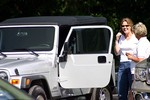 Lynnette closing the deal on her new 2004 Jeep Wrangler Unlimited at the used car dealership... but she still didn't drive it yet!