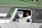 Lynnette driving her new Jeep Wrangler Unlimited off the lot for the first time.