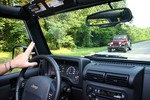 Jim doing 'the Jeep Wave' with a fellow Jeeper driving along the Natchez Trace.